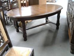 table ovale en plaqué chêne
